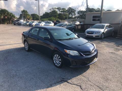 2012 Toyota Corolla for sale at Friendly Finance Auto Sales in Port Richey FL