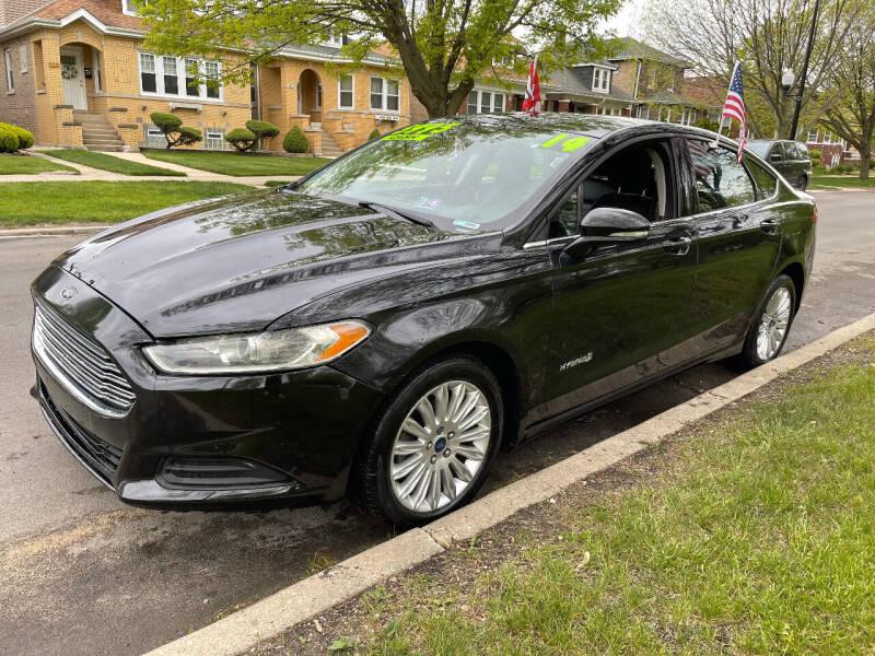 2014 Ford Fusion Hybrid for sale at Apollo Motors INC in Chicago IL