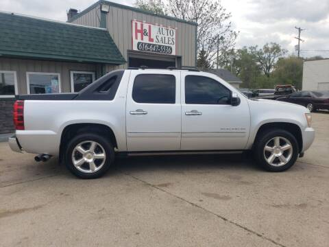 2012 Chevrolet Avalanche for sale at H & L AUTO SALES LLC in Wyoming MI