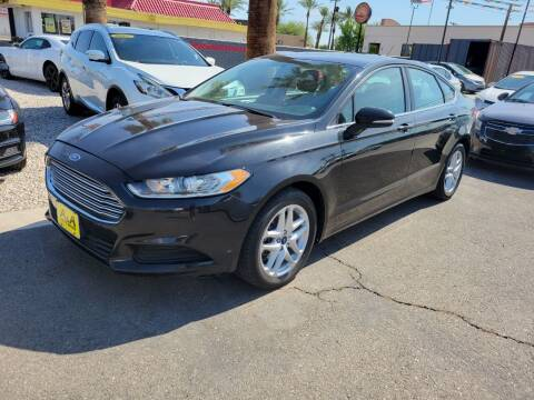 2014 Ford Fusion for sale at A AND A AUTO SALES in Gadsden AZ