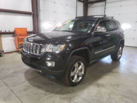 2011 Jeep Grand Cherokee for sale at Hometown Automotive Service & Sales in Holliston MA