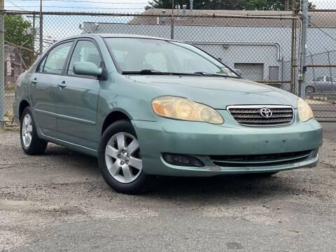 2007 Toyota Corolla for sale at Illinois Auto Sales in Paterson NJ