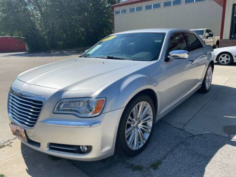 2012 Chrysler 300 for sale at Azteca Auto Sales LLC in Des Moines IA