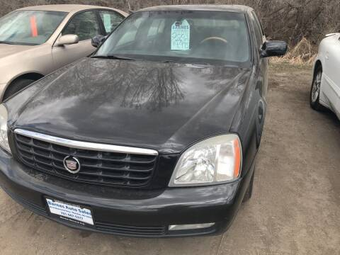 2005 Cadillac DeVille for sale at BARNES AUTO SALES in Mandan ND