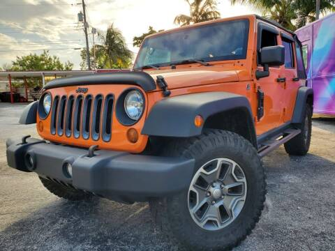 2013 Jeep Wrangler Unlimited for sale at Barbie's Autos Corp in Miami FL