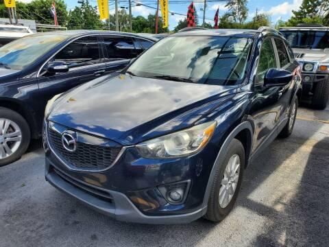 2014 Mazda CX-5 for sale at America Auto Wholesale Inc in Miami FL