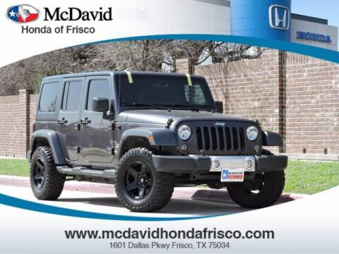 2014 Jeep Wrangler Unlimited for sale at DAVID McDAVID HONDA OF IRVING in Irving TX