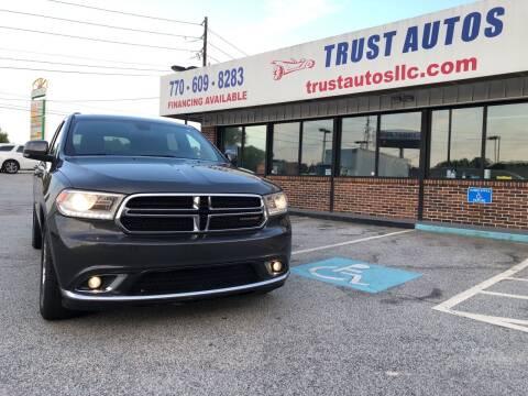 2014 Dodge Durango for sale at Trust Autos, LLC in Decatur GA
