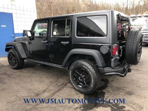 2013 Jeep Wrangler Unlimited for sale at J & M Automotive in Naugatuck CT