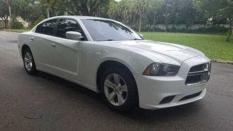 2014 Dodge Charger for sale at DELRAY AUTO MALL in Delray Beach FL