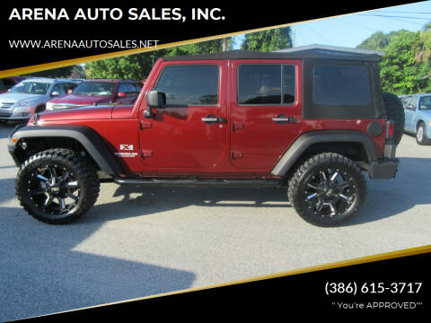 2009 Jeep Wrangler Unlimited for sale at ARENA AUTO SALES,  INC. in Holly Hill FL