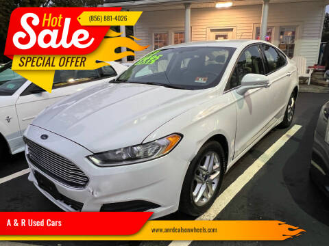 2013 Ford Fusion for sale at A & R Used Cars in Clayton NJ