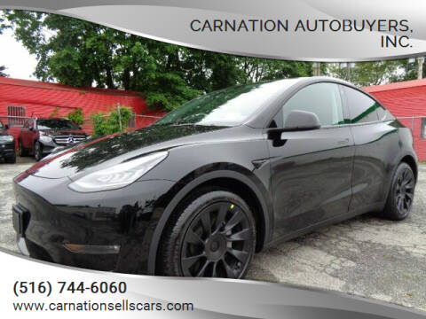 2021 Tesla Model Y for sale at CarNation AUTOBUYERS Inc. in Rockville Centre NY