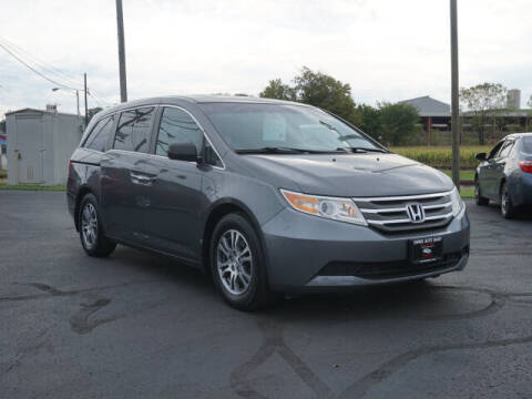 2012 Honda Odyssey for sale at SWISS AUTO MART in Sugarcreek OH