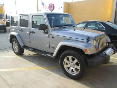 2013 Jeep Wrangler for sale at Pasadena Auto Planet in Houston TX