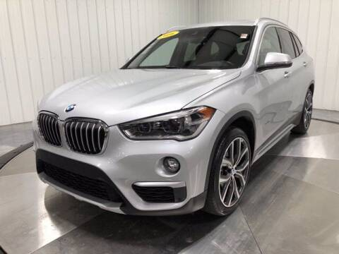 2016 BMW X1 for sale at HILAND TOYOTA in Moline IL