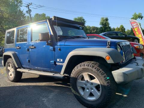 2009 Jeep Wrangler Unlimited for sale at D & M Discount Auto Sales in Stafford VA