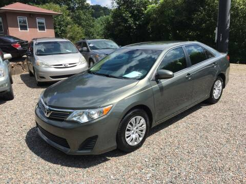 2014 Toyota Camry for sale at R C MOTORS in Vilas NC