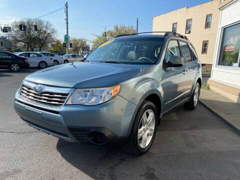 2010 Subaru Forester for sale at ADAM AUTO AGENCY in Rensselaer NY