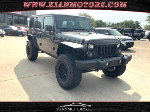 2014 Jeep Wrangler Unlimited for sale at KIAN MOTORS INC in Plano TX