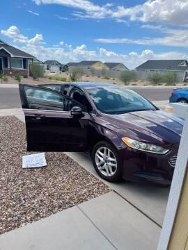 2013 Ford Fusion for sale at DIAMOND LUXURY AUTO SALES LLC in Phoenix AZ