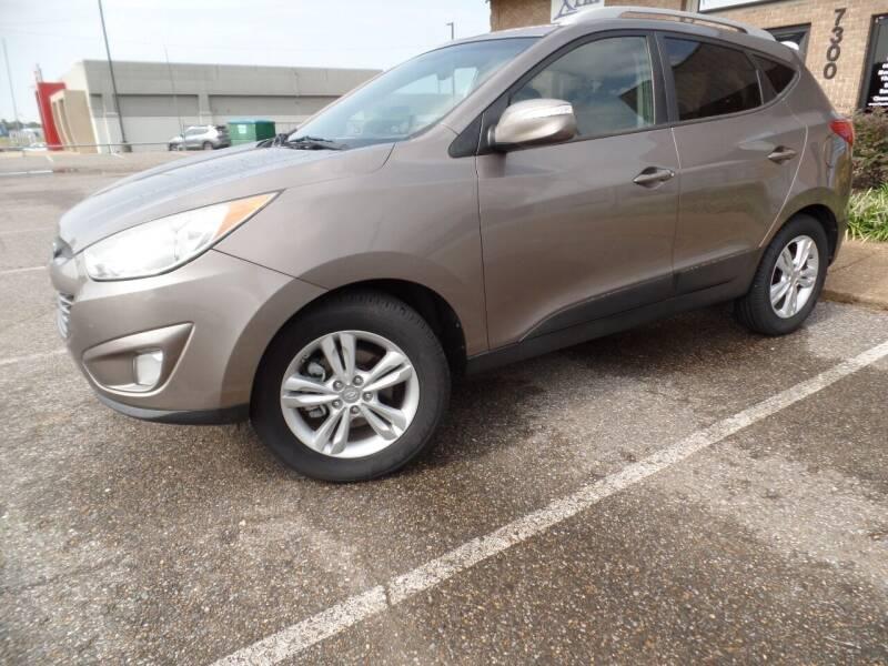 2013 Hyundai Tucson for sale at Flywheel Motors, llc. in Olive Branch MS