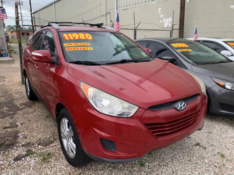 2012 Hyundai Tucson for sale at CHEAPIE AUTO SALES INC in Metairie LA