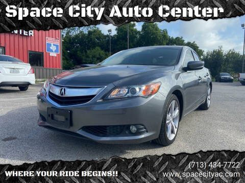 2014 Acura ILX for sale at Space City Auto Center in Houston TX