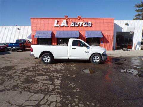 2014 RAM Ram Pickup 1500 for sale at L A AUTOS in Omaha NE