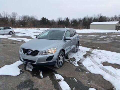 2011 Volvo XC60 for sale at Caruzin Motors in Flint MI