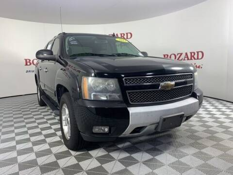 2011 Chevrolet Avalanche for sale at BOZARD FORD in Saint Augustine FL