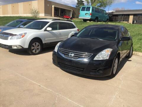 2010 Nissan Altima for sale at QUEST MOTORS in Englewood CO