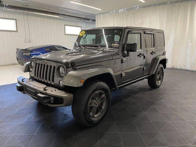 2016 Jeep Wrangler Unlimited for sale at Monster Motors in Michigan Center MI