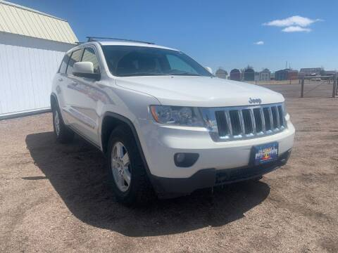 2012 Jeep Grand Cherokee for sale at Praylea's Auto Sales in Peyton CO