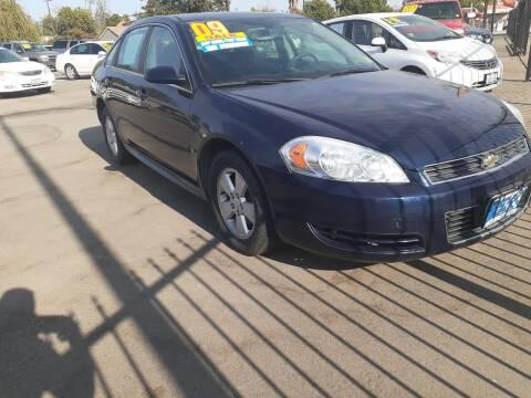 2009 Chevrolet Impala for sale at COMMUNITY AUTO in Fresno CA