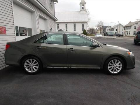 2014 Toyota Camry for sale at VILLAGE SERVICE CENTER in Penns Creek PA