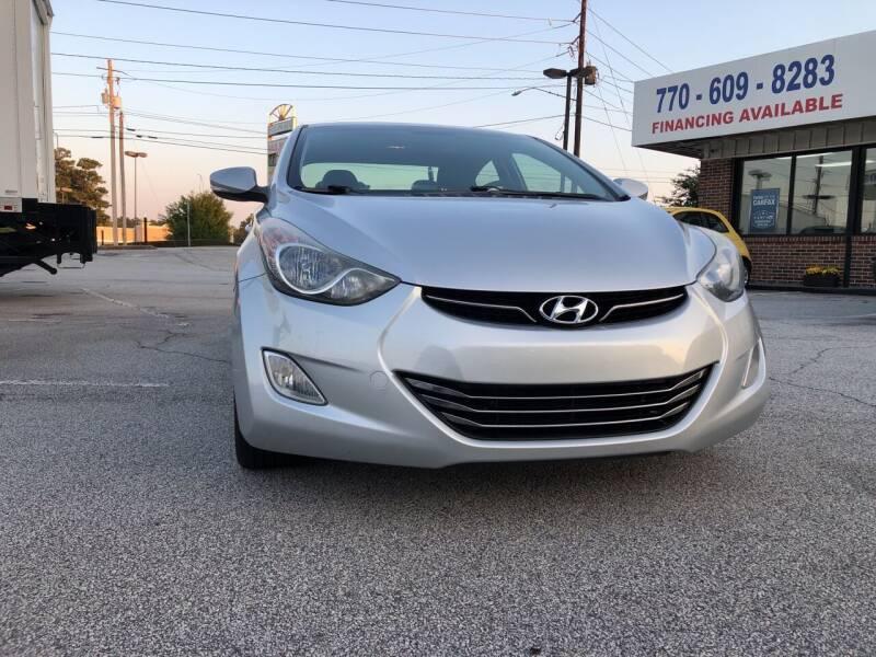 2012 Hyundai Elantra for sale at Trust Autos, LLC in Decatur GA