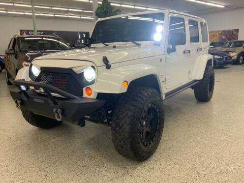 2013 Jeep Wrangler Unlimited for sale at Dixie Motors in Fairfield OH