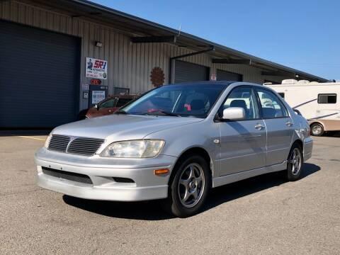 2002 Mitsubishi Lancer for sale at DASH AUTO SALES LLC in Salem OR