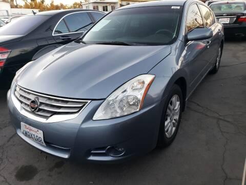 2010 Nissan Altima for sale at MCHENRY AUTO SALES in Modesto CA