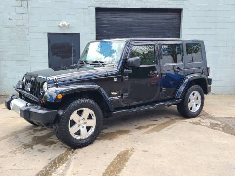 2009 Jeep Wrangler Unlimited for sale at Kevin Lapp Motors in Plymouth MI