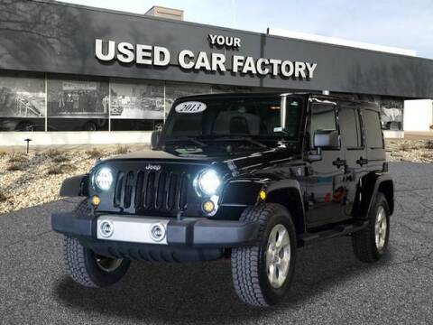 2013 Jeep Wrangler Unlimited for sale at JOELSCARZ.COM in Flushing MI