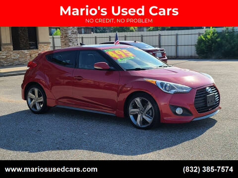 2013 Hyundai Veloster for sale at Mario's Used Cars in Houston TX