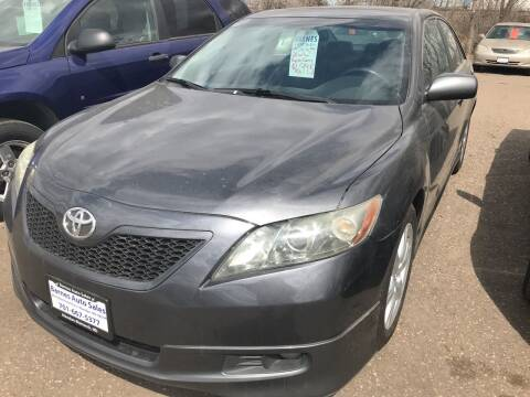 2007 Toyota Camry for sale at BARNES AUTO SALES in Mandan ND