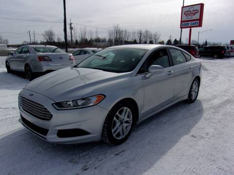 2015 Ford Fusion for sale at DAVE KNAPP USED CARS in Lapeer MI