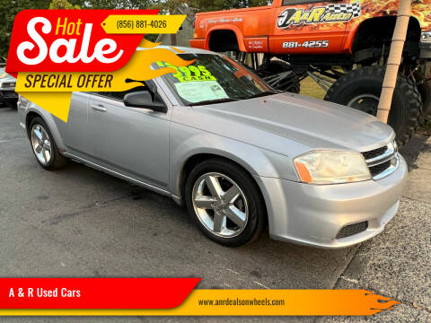 2013 Dodge Avenger for sale at A & R Used Cars in Clayton NJ
