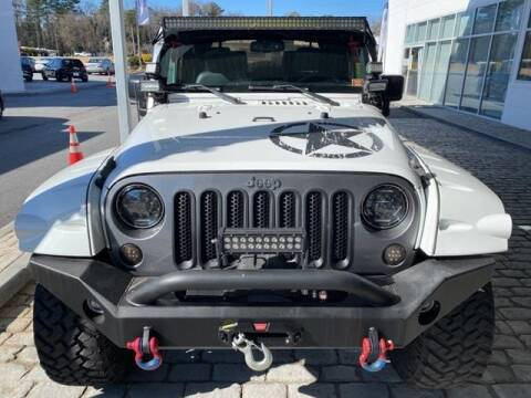 2015 Jeep Wrangler for sale at CU Carfinders in Norcross GA