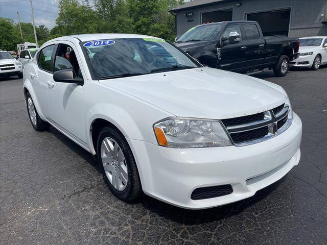 2014 Dodge Avenger for sale at HUFF AUTO GROUP in Jackson MI