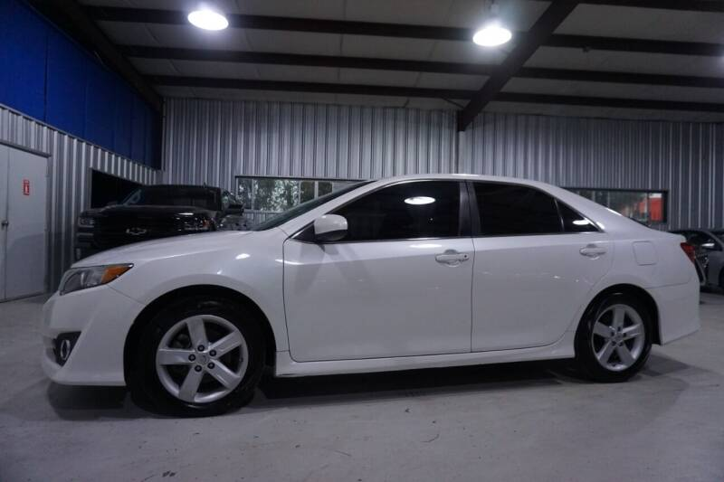 2014 Toyota Camry for sale at SOUTHWEST AUTO CENTER INC in Houston TX