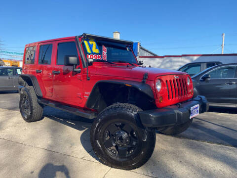 2012 Jeep Wrangler Unlimited for sale at Latino Motors in Aurora IL